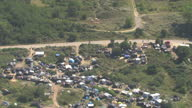 Aerial shots of the migrant camp known as 'the jungle' on the outskirts of Calais>> on July 29 2015 in Calais France