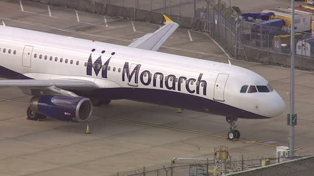 Aerial shots of two Monarch Airlines planes parked at Gatwick Airport following the announcement that the company has ceased trading and cancelled...