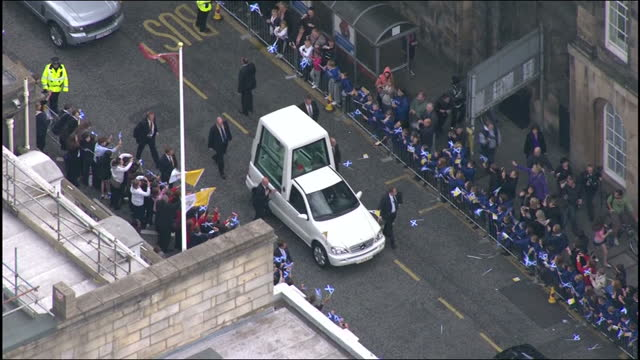 Aerial shots Pope Benedict XVI travels through Edinburgh in the Pope Mobile past cheering crowds Pope Benedict XVI aerials through Edinburgh on...