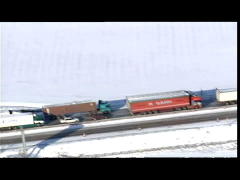 aerial shots unmoving traffic cars lorries backed up on snowy M11