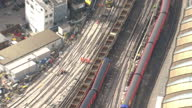 Aerial shots various of South West Trains train derailed at the front near London Waterloo train station groups of staff engineers rail workers...