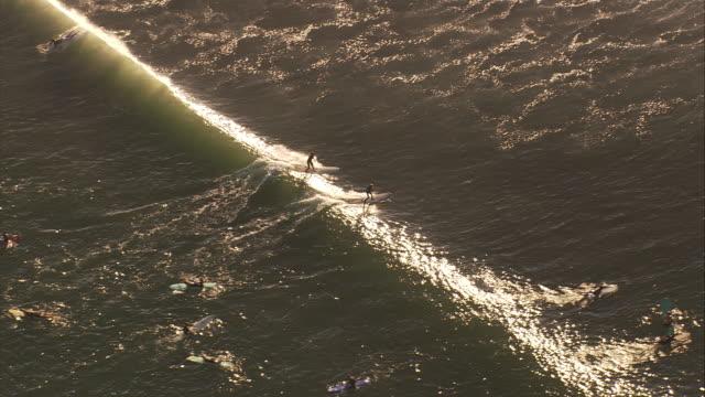 Aerial TS HA single surfer at Malibu Beach, California, United States.