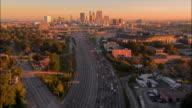 Aerial slow traffic on motorway heading into city/ Atlanta, Georgia