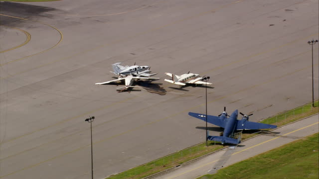 AERIAl small planes crashed by storm on runway at Lakefront Airport / New Orleans Louisiana