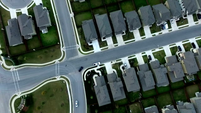 Aerial Straight Down View Neighborhood Housing Community Round Rock near Austin , Texas Suburbia Streets houses roads yards house to house