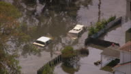 Aerial sunken cars on flooded street / zoom out flooded Gentilly subdivision / New Orleans Louisiana