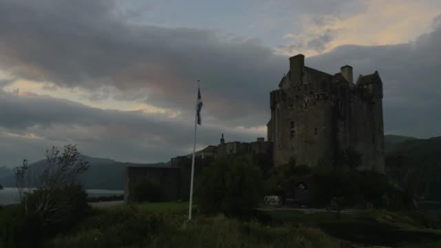 Aerial sunset view Eilean Donan castle Loch Duich