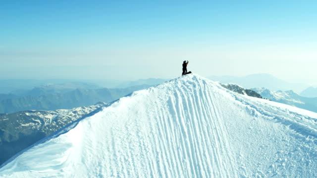 Aerial Swiss Jungfrau mountain summit climbers Alps outdoor