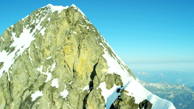 Aerial Swiss Monch summit Alps snow ice snow