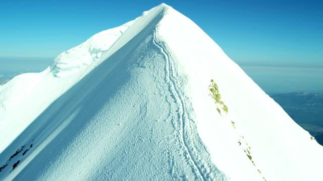 Aerial Swiss mountain Alps mountaineering snow climbers travel