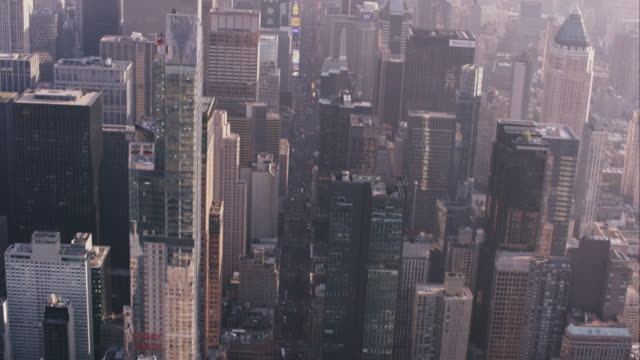 Aerial tilting up from 59th street to reveal Midtown and Lower Manhattan, NYC