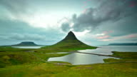 Aerial Timelapse video of Moving cloud at twilight, Kirkjufell mountain