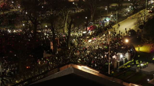 Aerial TL of anti-racism demonstration in front of State House in Boston. Zoom In