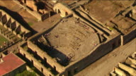 Aerial tourists visiting Odeon Theatre and palaestra / Pompeii