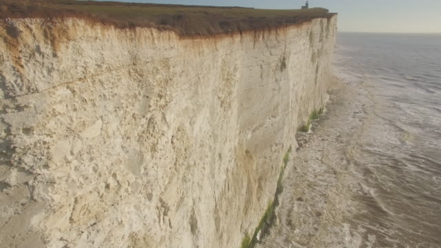 Aerial track along chalk cliff face