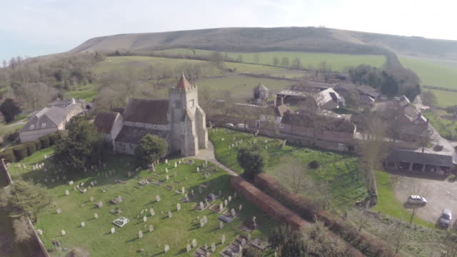 Aerial track around Norman church in Firle, East Sussex