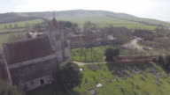 Aerial track away from Norman church in Firle, Sussex.