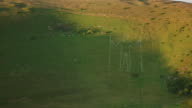 4K aerial track past Long Man at dawn