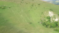 4K aerial track towards Long Man of Wilmington chalk carving in Sussex