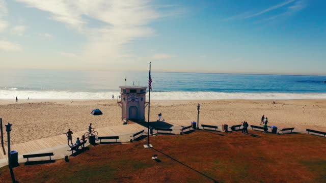 Aerial tracking shot of a lifeguard station in Southern California's Laguna Beach.