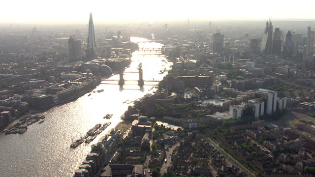 Aerial tracking shot of the Thames River in London passing iconic buildings including London Bridge The Shard The London Eye Aerial Tracking Shot of...