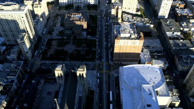 Aerial vertical view of rooftop city buildings traffic
