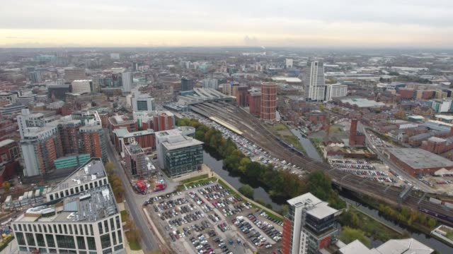 Aerial Video Approaching Leeds Train Station and River Aire