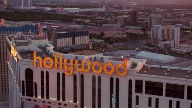 Aerial video flying around Planet Hollywood Resort & Casino, view of The Strip, sunrise