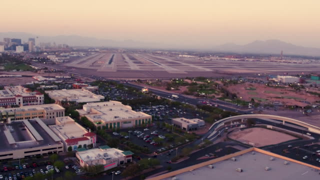Aerial video flying around South of Las Vegas and McCarran International Airport  Sunset