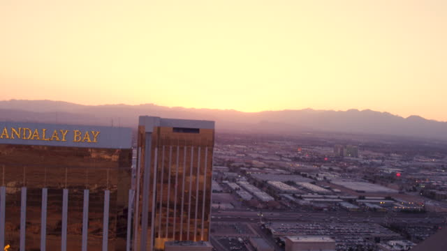 Aerial video flying close to Mandalay Bay Hotel and Casino, Sunset