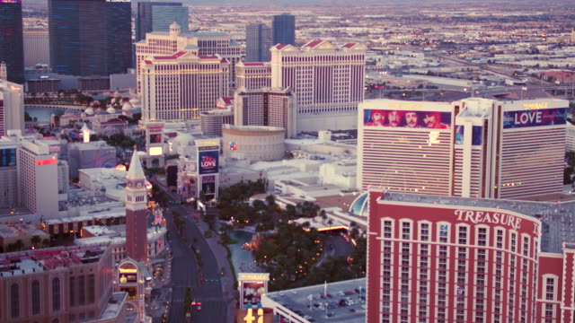 Aerial video flying over Las Vegas Strip looking South, sunset