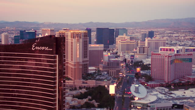 Aerial video flying over North end of Las Vegas Strip looking South, sunset