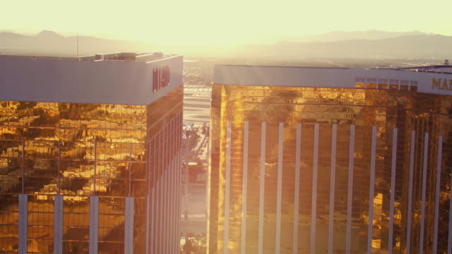 Aerial video flying over The Las Vegas Strip, around Hotels & Casinos, sunrise