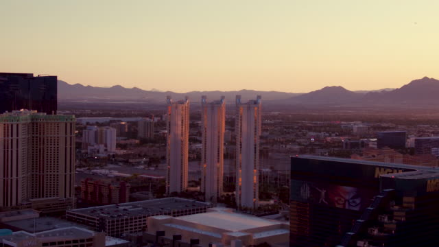 Aerial video flying over the Las Vegas Strip, camera panning right, sunrise