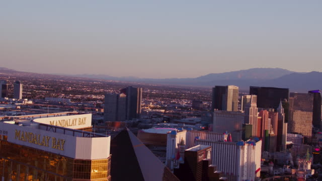 Aerial video flying over The Las Vegas Strip, Hotels & Casinos, sunrise