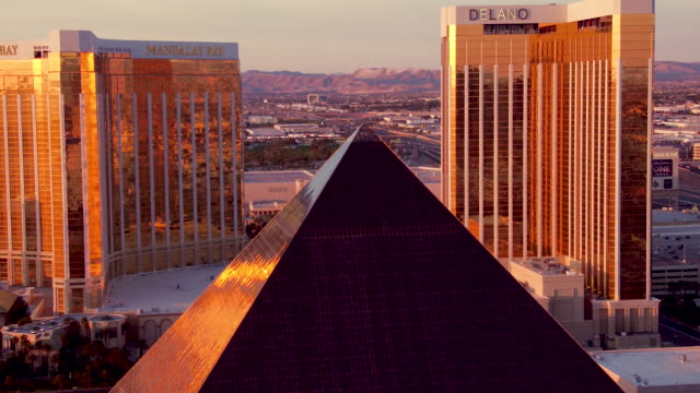 Aerial video flying over The Las Vegas Strip, Luxor Hotel & Casino, Sunset