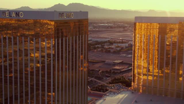 Aerial video flying over The Las Vegas Strip, Luxor Hotel & Casino, sunrise