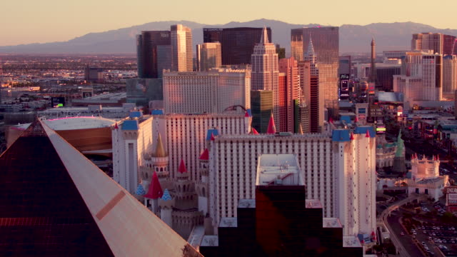 Aerial video flying over The Las Vegas Strip, view of Hotels & Casinos, Sunrise