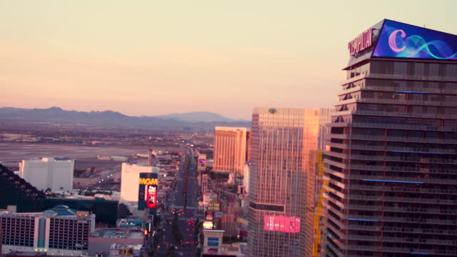 Aerial video flying South down The Las Vegas Strip, Sunrise