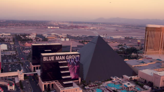 Aerial video flying South down The Las Vegas Strip, Sunset