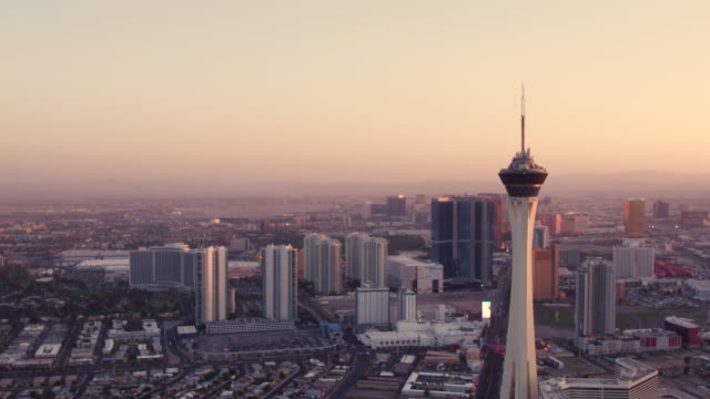 Aerial video flying South towards Las Vegas Strip, Sunset