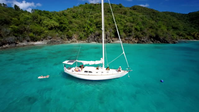 aerial video of family on a sailboat in St.John, USVI