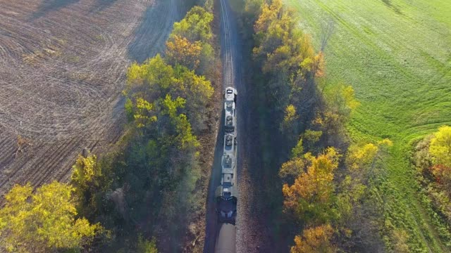 Aerial video of Freight Train going through Countryside