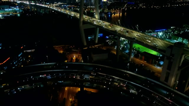 Aerial View Above of Busy Highway Road Junctions at Night,Nanpu bridge at Shanghai,CHina