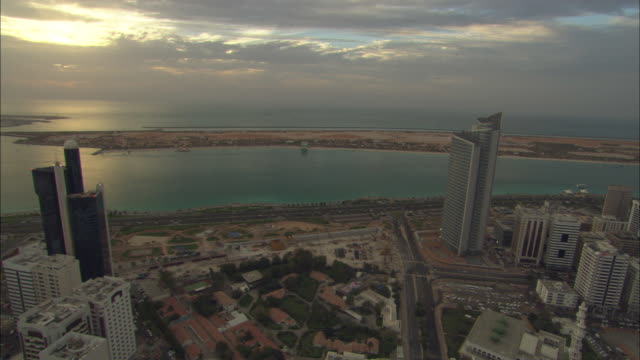 Aerial view Ahbu Dabi, city and waterfront, sun setting, Abu Dhabi, United Arab Emirates