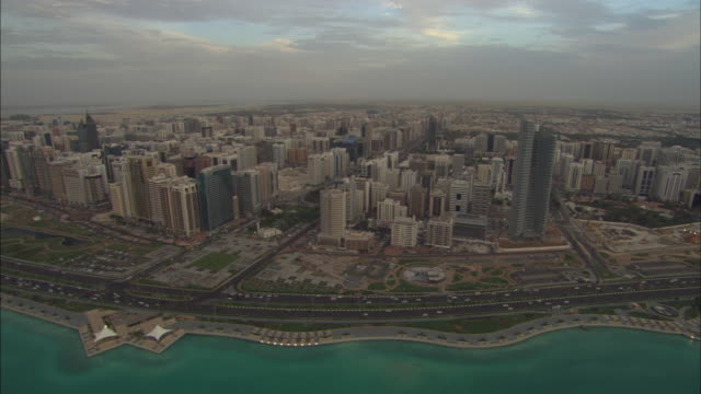 Aerial view Ahbu Dabi, waterfront with city, sun setting, Abu Dhabi, United Arab Emirates