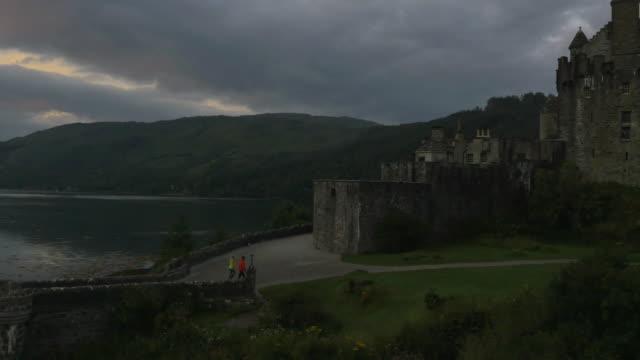 Aerial view at dusk Eilean Donan castle Scotland