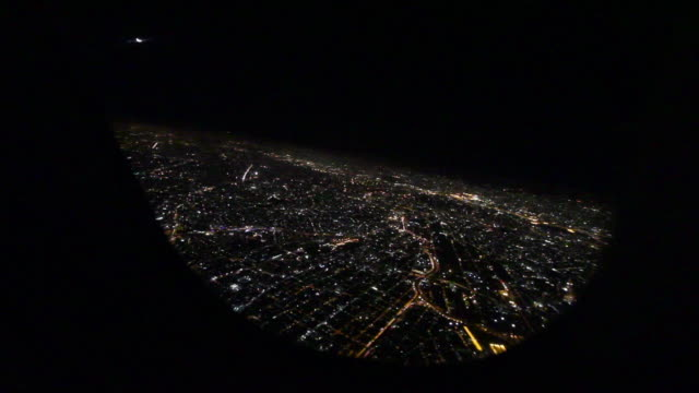 Aerial View at night from a window on a passenger aircraft / São Paulo, Brazil