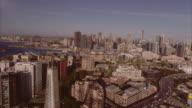 Aerial view flying high past the Anzac Bridge facing Sydney city. Australia