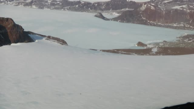 Aerial view flying over Antarctic icefields